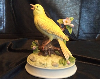 Yellow canary bisque porcelain on branch music box