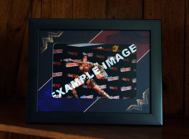 Black frame with a professionally printed 2 inch Mount to fit a 6 x 4 Inch photo. Wonder Woman Style Picture Frame