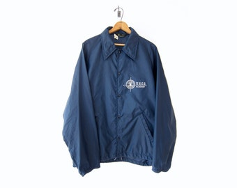50% of Proceeds go to Planned Parenthood! Vintage 60's/70's Champion Coach Jacket, US Coast Guard Academy, Blue Nylon Windbreaker, Large/XL