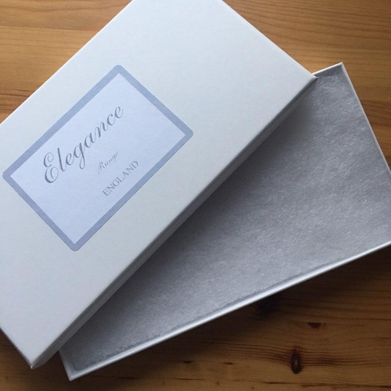 light blue and ivory available in SM /& Plus sizeLarge Something Blue Wedding Garter