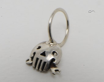 Skull pendant with monkey wrench in arg. 925
