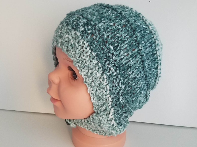 3f261e56e3e Ear flap baby hat buttoned chin strap hand knit in low pill