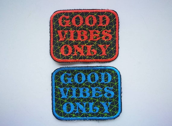Embroidered Patches on yarn. GOOD VIBEs ONLY Bright Orange neon or blue Colors with decorative isometric grid.