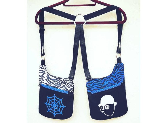 Cartridge strips Holsterbags 2 zippered bags white and blue zebra with screen printing of cobweb and orange mechanics