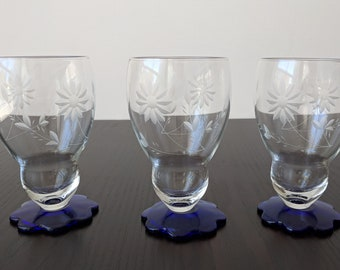 three vintage parfait cups with a cobalt base