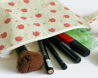 Make-up bag, pouch, pencil case, clutch made from pink vinyl with bunnies - Water resistant Japanese fabric