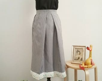 Striped skirt with detail on the bottom