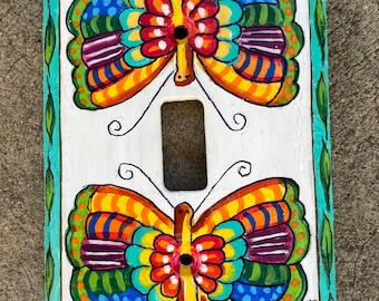 Hand painted wood light switch plate of butterflies and leaves