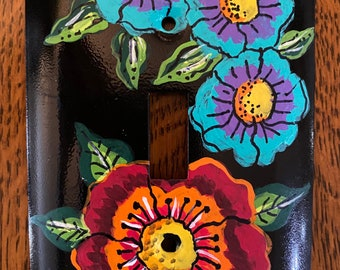 Hand painted bright flowers on black metal light switchplate cover