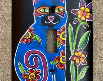 Hand painted light switch plate with a cute cat, bird and flowers
