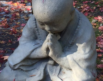 Photo of a carved statue at the Portland Japanese Gardens during Fall