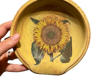 Yellow sunflower round ceramic spoon rest - ochre and green - hand painted ceramic pottery that supports environmental conservation