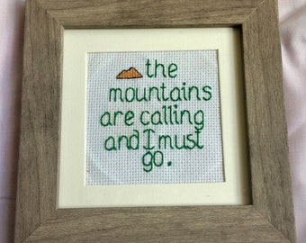 The Mountains are calling and I must go- single framed cross stitch