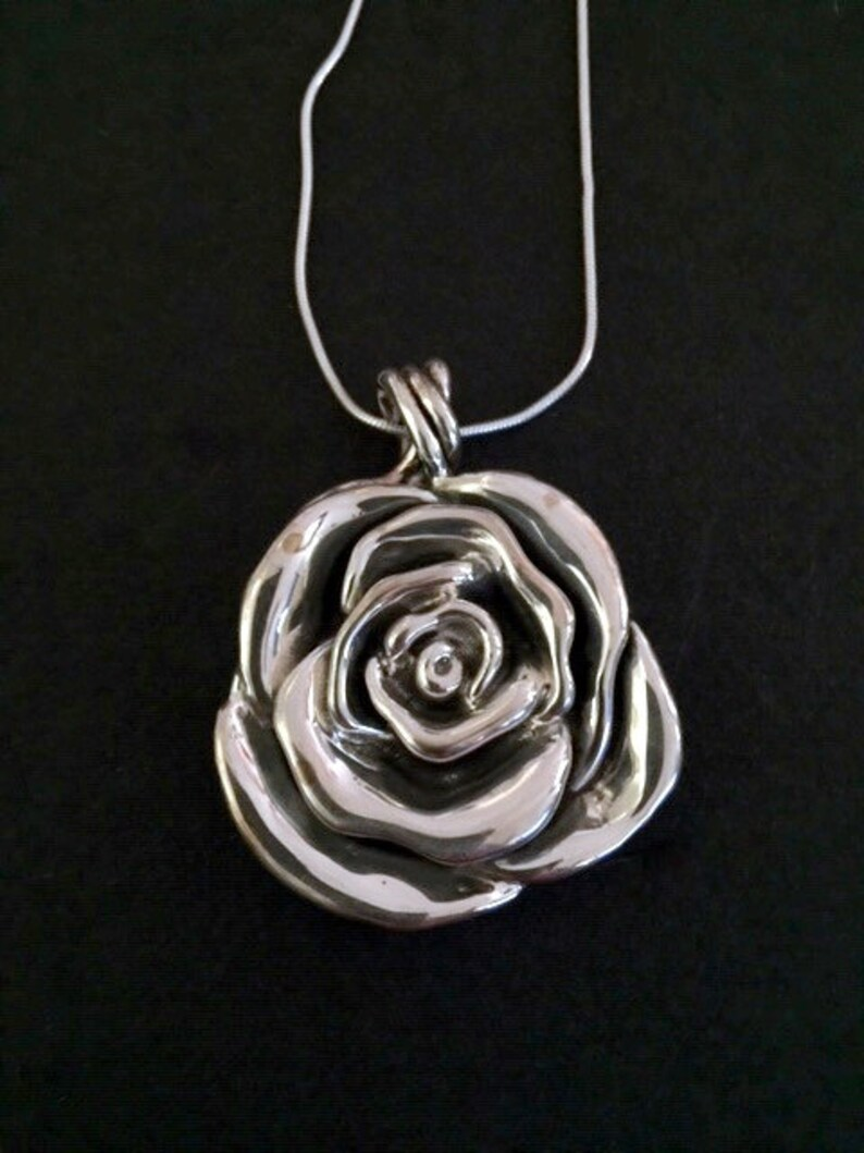 c987431611fe8 Sterling Silver Rose Pendant Necklace from the Statements by Passage to  Israel Collection