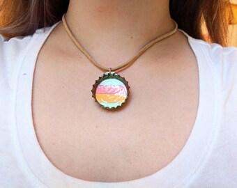 Bottle cap necklace on beige leather necklace