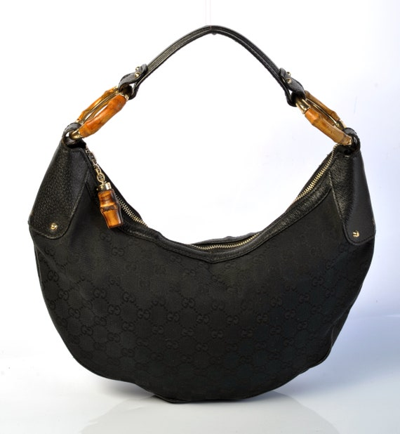 47278a7ccc7 Authentic Gucci monogram black hobo bag with bamboo rings