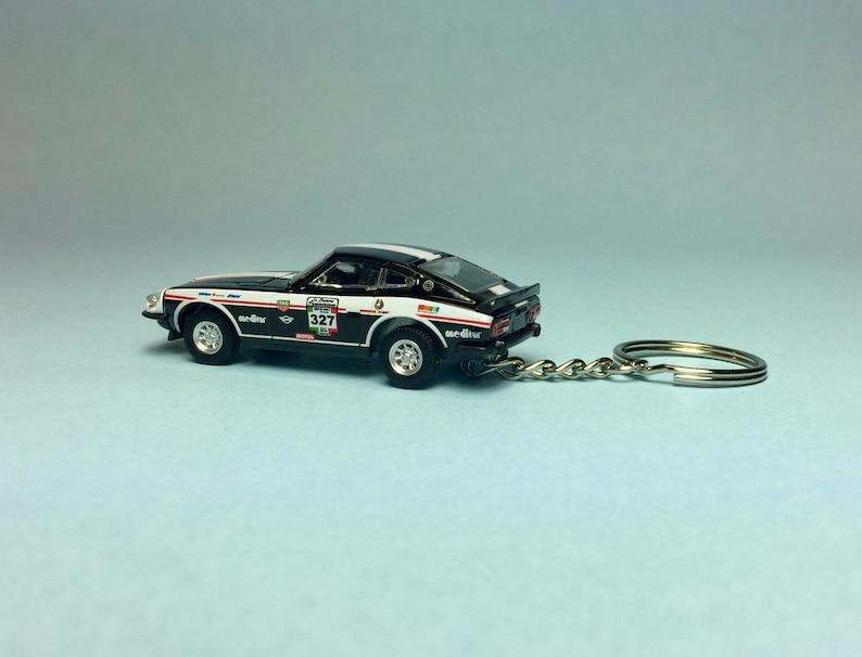 La Carrera Panamericana Mexico Rally Novelty keychain made from 164 scale die cast model car 1974 Datsun 260Z
