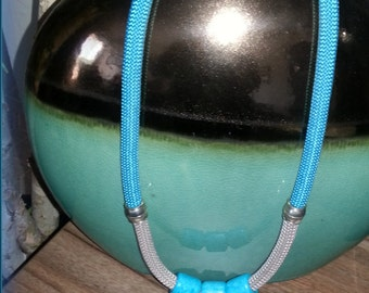 Aqua and  Beige cord necklace with large aqua beads and magnetic closure.