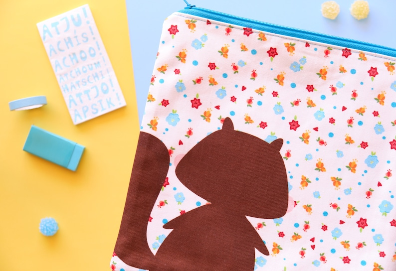 Cute squirrel pouch with flowers illustration