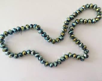 Crystal bead has facet 6 * 8 mm AB green color that goes to blue