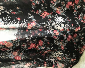 Black chiffon with flowers in 145 cm wide