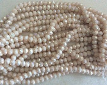 Crystal bead has facet 6 * 8 mm beige powder