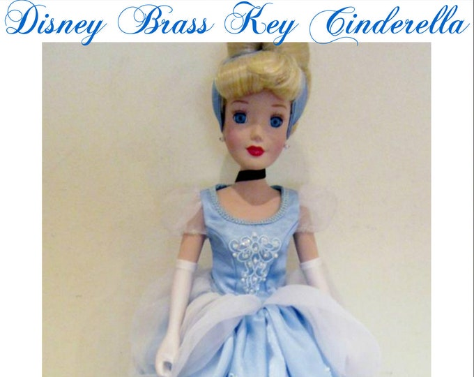 Toys- Disney 25th Anniversary Cinderella Brass Key Porcelain Doll in her Original unopened Box Mint Condition