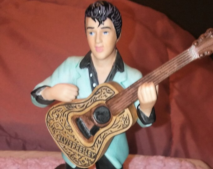 Avon Elvis Presley 1987 Figurine, Walking in Memphis, Elvis with his Guitar in his favorite Stance,  Mint Condition.