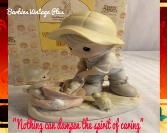 """Precious Moments Figurine """"Nothing can dampen the spirit of caring"""" in the original box, excellent condition w/ reduced shipping"""