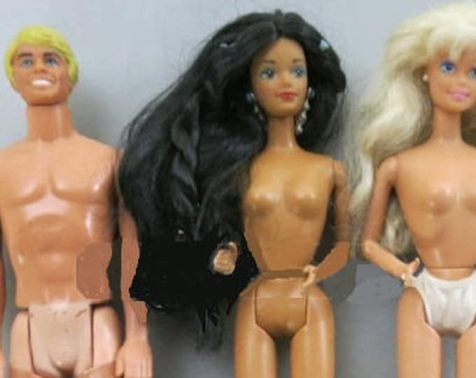 Barbie's and Ken with Dates on each of the bodies , Ken 1968, both Barbie's dated 1966, With Reduced Shipping