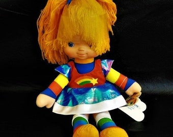 1983 Rainbow Bright Doll by Hallmark with the original tags, She still has plastic around the back of her hair, In Excellent Condition.