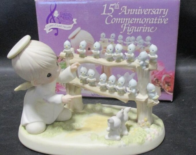 15th Anniversery Precious Moments Figurine, Collectors Edition, In the original box, Listed as one of the top Valued Precious Moments