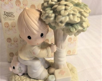 """Precious Moments Figurine, """"Money is not the only thing Gree worth saving"""" from 1994, In the original box , Excellent Condition"""