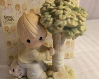 """Precious Moments Figurine """"Money is not the only green thing worth saving"""" in the original box , Excellent Condition w/ Reduced Shipping"""