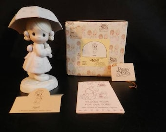 """April Birthday Gift, Precious Moments """"APRIL"""" Retired Figurine in Excellent Condition with original box. Excellent Condition. Reduced Ship"""