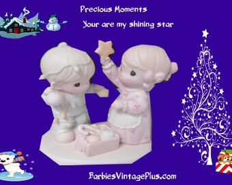 """1992 Precious Moments Figurine """"You are my Shining Star"""" in the original box, In mint condition, The little girl is putting the star on him"""