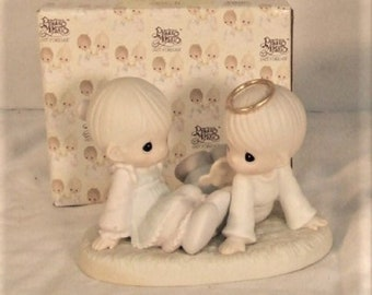 "Precious Moments Figurine ""Heaven Must have sent you "" in the original box , Excellent Condition w/ Reduced Shipping"