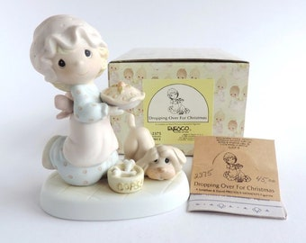 """Precious Moments Christmas Figurine, """"Dropping over for Christmas"""" in the original box in Excellent Condition"""