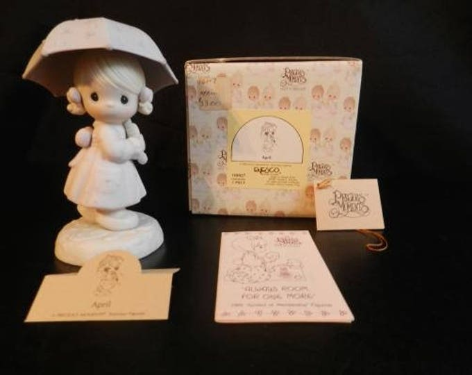 "Precious Moments ""APRIL"" Retired Figurine in Excellent Condition with original box"