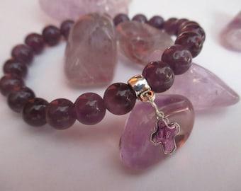 Amethyst bracelet and Holy Cross dedicated to wisdom.