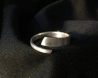 Sterling silver wrap around band size 8 with brushed finish