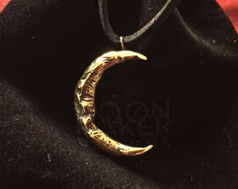 Sterling silver and brass moon pendant on leather cord