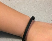 1/4 inch black bracelet with a message on the inside