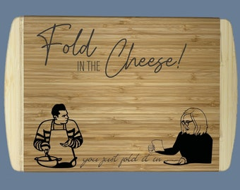 """Fold In The Cheese Cutting Board 