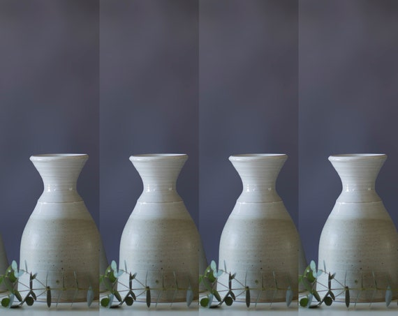 Carafes or vases your choice.  Capacity 750 ml
