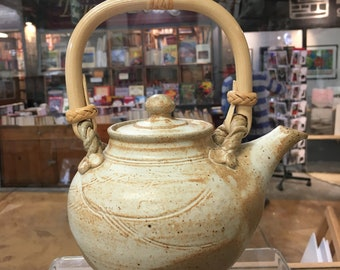 SOLD Australian handmade ceramic teapot.  This superb pourer and generous, 4 - 5 cup stoneware teapot with cane handle is an ideal gift.
