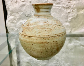 Free delivery in Australia. Small bud vase light 'shino' glaze .