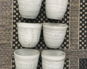 Free delivery in Australia. Great coffee, tea, wine or ? cups.  Smooth soft white glaze on stoneware.