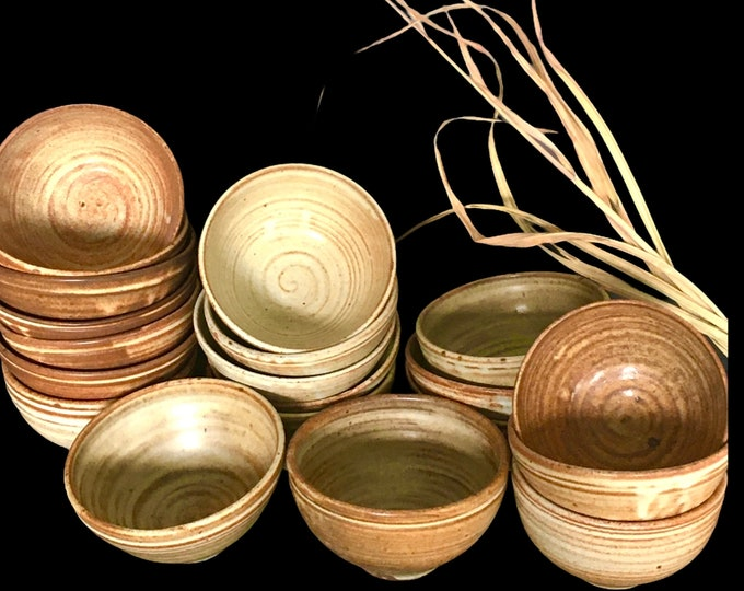 Small bowls ranging in colour from dark golden brown to creamy  brown