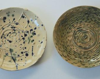 2 art studio pottery dishes. British artisan made decorative plates